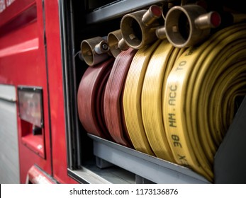 Fire hose rolled with connections