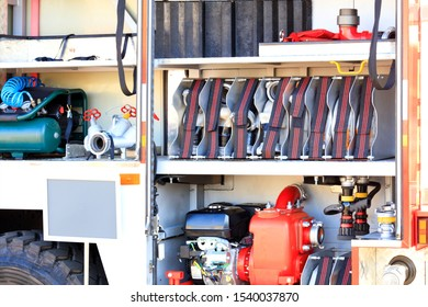 Fire hoses, cranes, hydrants, air compressor, fire pumphigh pressure pump are located in the cargo compartment of an equipped fire truck, free copy space.