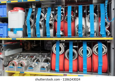 Fire hoses rolled together on an extinguishing vehicle