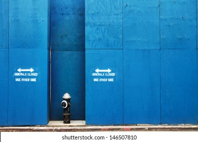 Fire Hydrant in Front of a Blue Painted Construction Wall in New York City