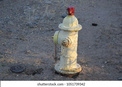 Fire hydrant has a locking device on top of the stem to prevent people from tampering with it, in Phoenix, Arizona, USA.