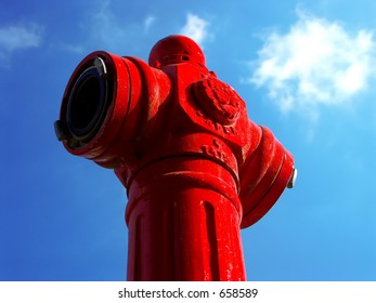 Fire hydrant on a blue sky  with white clouds background