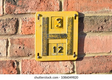 Fire Hydrant Sign on wall - the sign indicates the location of t
