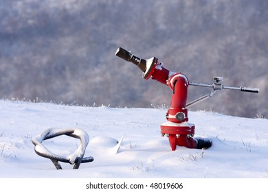 Fire hydrant in the snowy helipad, Italy (also known colloquially as fire plug in the United States or as johnny pump in New York City).