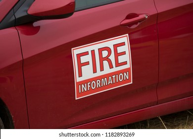 Fire information sign on a red emergency vehicle in the Willamette National Forest of Oregon during the Terwilliger Fire at Cougar Reservoir.