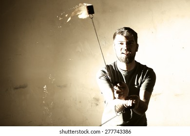fire juggler with spinning flames