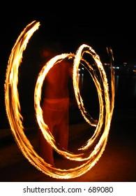Fire Juggling. Slow Shutter speed shot