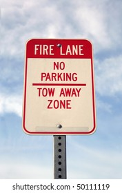 Fire Lane. No parking and tow away zone sign