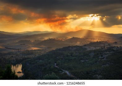 Fire and Light - The setting sun from Shepherds Lookout set against the fire hazard reduction burns taking place in the Brindabella ranges - Canberra, Australia.