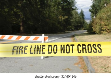 Fire line do not cross sign hanging across the road