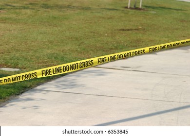 """FIRE LINE DO NOT CROSS"" yellow caution tape"
