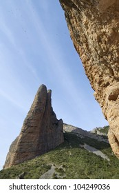Fire Mallo in Riglos mountains and vultures flying, Huesca, Aragon, Spain