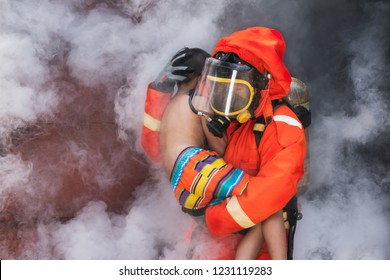 Fire man carry the victim child out of thick smoke and fire