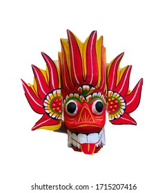 A Fire mask made of wood and painted in vibrant colours. It is a traditional Sri Lankan mask known as Raksha mask. Used in many festivals and cultural events. Its job is to scare off evil.