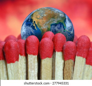 fire match and the earth, global warming and climate change concept background, hot weather in the world, environment,  including elements furnished by NASA.