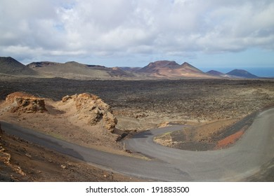 Fire mountains and barren volcanic lava landscape in Timanfaya national park, Lanzarote island, Spain