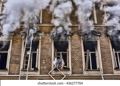 fire in the old house. window facade close-up