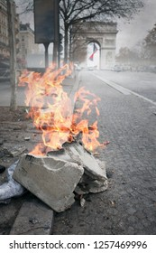 Fire on the Champs Elysees after violent protest in Paris, France