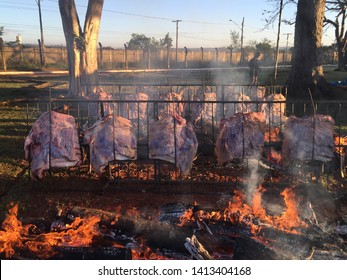 Fire on the floor, traditional barbecue mainly from the southern region of Brazil, beef chops, tasty meat cutting, the brazier is made with branches and wood logs.