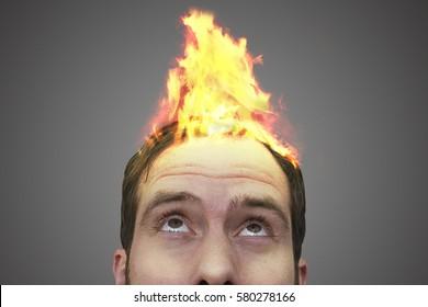 Fire on a man's head.