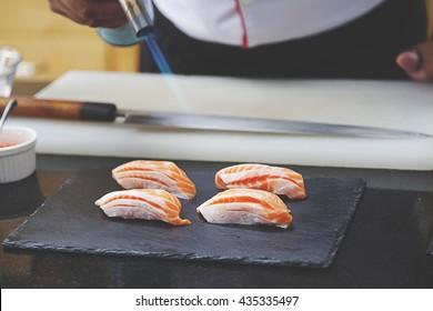 Fire on sushi,burn salmon