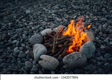 fire overlaid with stones is burning