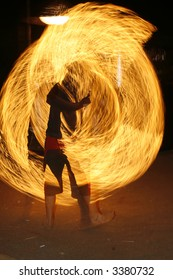 fire performer in a rave party outdoors