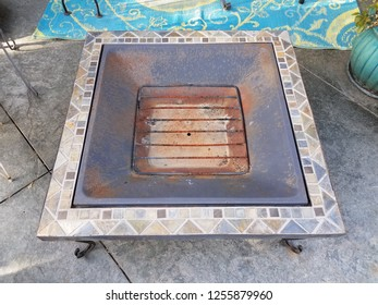 fire pit or grill on grey cement