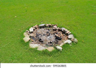 Fire pit made of rocks on the camping grounds