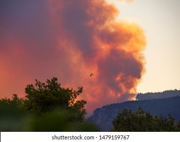 Fire planes on the background of smoke from fire and fire on the Greek island of Evia, Greece