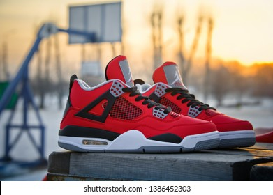 67e55a2ab1e Fire Red Nike Air Jordan IV Retro basketball shoes in sunset light. Famous  sneakers shot