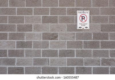 Fire Route sign on cement block wall