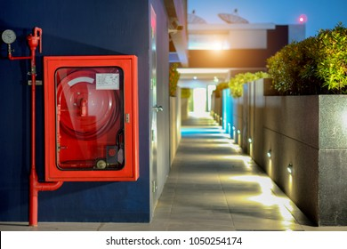 Fire Safety Concept, Fire extinguisher and fire hose reel in public building corridor