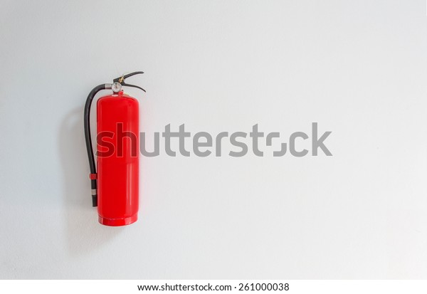 Fire safety on white cement wall background