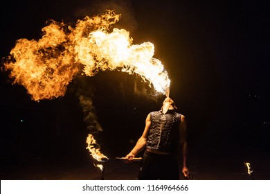 Fire show artist breathe fire in the dark jamp