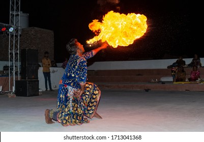 Fire Show, Man breathing fire and dancing with flame, Jaisalmer, India - November 2019