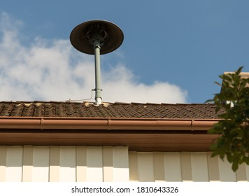 Fire siren on a roof in a village
