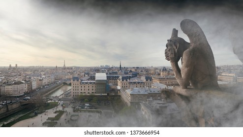 Fire smoke around a gargoyle on Notre Dame cathedral in Paris, France