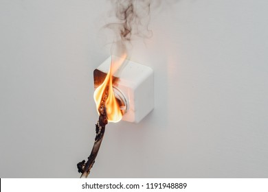 Fire and smoke in electrical outlet. Short circuit house wiring.