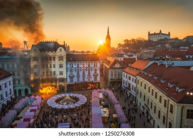 Fire and Smoke in Historical Building on Main Square, Bratislava, Slovakia at Sunset with Several Landmarks in Background