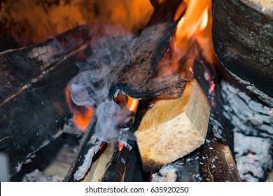 Fire and smoke on burning wood in the stove