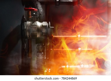 Fire, smoke and steam in a boiler room. Copper pipes  and valves on a wet boiler. Close up
