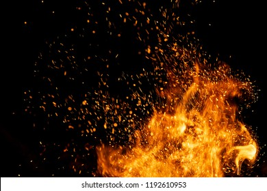 Fire sparks particles with flames isolated on black background.