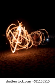 fire spinning on full moon in miami beach