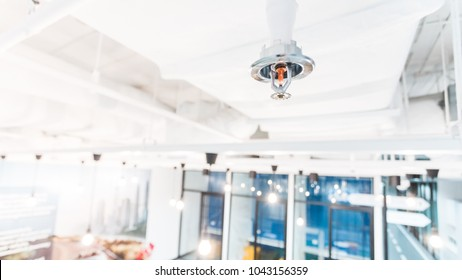 Fire Sprinkler in office building blur background., focus at selective