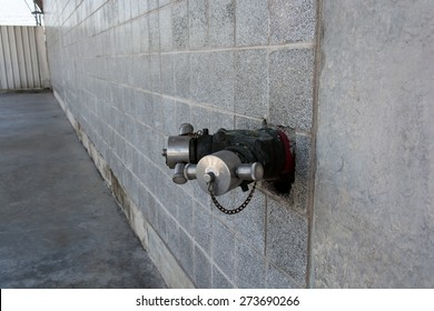fire standpipe on a City wall.