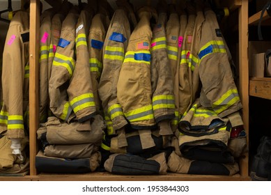 fire structure bunker gear supply ready to use in supply room of fire department - Shutterstock ID 1953844303