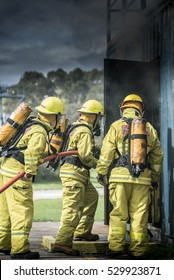 Fire Team in Breathing Apparatus Enter Building