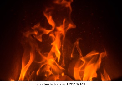 Fire Texture on dark background. Red Flames burning in oven. Abstract hot element.