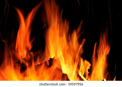 Fire tongues against a dark background